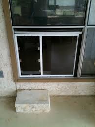 pet door installed in window
