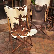 two tripolina folding chairs in cavallino and brown leather