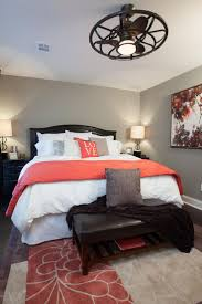 MASTER BEDROOM, AFTER: This newly renovated bedroom is warm and inviting  with brand new hardwood floors, unique ceiling fan and pops of coral  through the ...