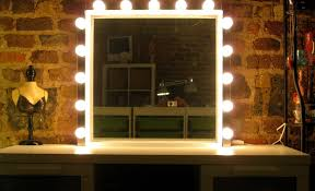 an ikea molger mirror and three sets of musik lights to make a hollywood style