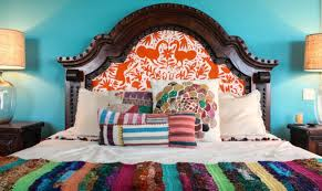 mexican style a rich turquoise wall works perfectly with layers of striped bedding and pillows image mina brinkey