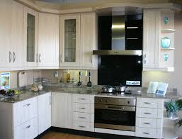 small kitchen with white built in cabinets and wrapped doors