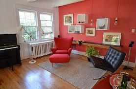 trendy little living space with plenty of red design nicole lanteri