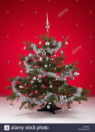 Decorating Christmas Tree With Balls Decorated Christmas Tree With Silver Balls On Red Background Stock 77