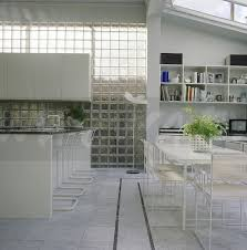 glass brick wall in large modern kitchen dining room with ceramic floor tiles