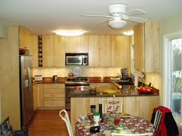 Decorating Small Kitchens Designing Small Kitchens With Simple Wooden Cabinet And Round