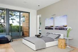 view in gallery contemporary bedroom in neutral tones sports sliding glass doors