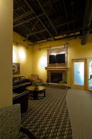 medical office interior design. This Dental Office Waiting Room Is Warm And Inviting With A Stone Fireplace Plush Carpet Medical Interior Design