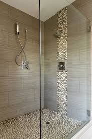 large charcoal shower tiles with a pebble accent