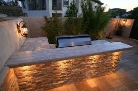 gallery outdoor kitchen lighting: l shaped outdoor kitchen stone counters outdoor kitchen lisa cox landscape design solvang ca