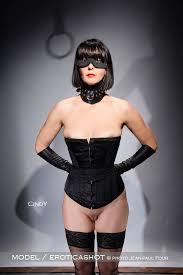 Naked women in bondage corsets