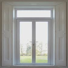 pvcu french doors with a with white finish and shutters
