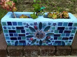 Cinder block mosaic planter. Great way to have an herb garden.