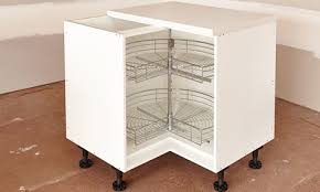 finish the cabinet by installing basket ware
