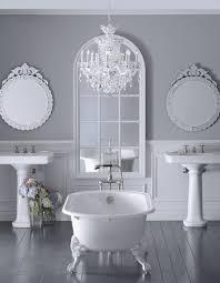 glamorous bathroom with a glass crystal chandelier