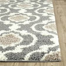 gray area rug and cream pellot light