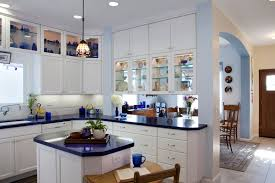 white painted kitchen cabinets recessed panel doors solid drawer fronts glass doors on upper island with