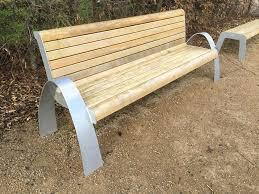aluminium and timber bench in a memorial garden at the national memorial arboretum alrewas