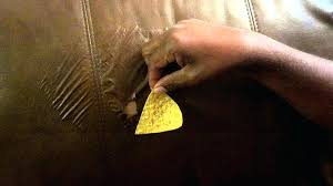 how to repair scratches on leather sofa in rip large tear scratched by scuffed brown shoes