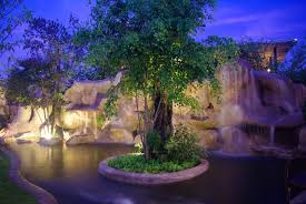 pool waterfall lighting. A Lighted Series Of Artificial Stone Waterfalls With Center Island Natural Trees. Pool Waterfall Lighting