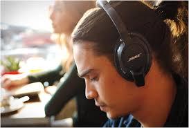 bose wireless headphones on person. bose wireless headphones on person