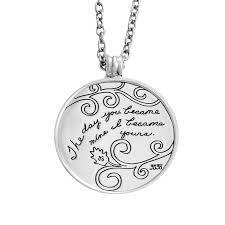 circle sterling silver pendant with engraved fl design and inspirational e that reads the day