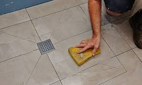 man cleaning the new shower base