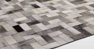 small gray parquet cowhide patchwork rug for contemporary interior flooring