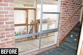 install a timber window frame before