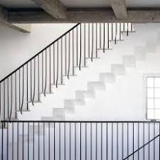 wrought iron railing. White Stairway With Contemporary Wrought Iron Railing