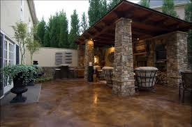 stained concrete patio to match the house stone work