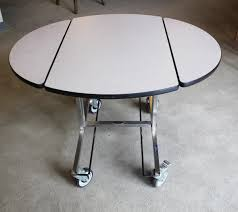 36 X 42 Oval Hotel Service Table Town Country Event Rentals