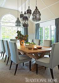 hung at staggered heights luminous lanterns from morocco cast a dazzling glow on a rustic dining room light fixturesdinning