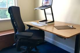 loud ones six month review of the herman miller em chair and jarvis bamboo standing desk