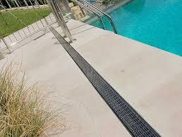 stylish linear drainage around the pool