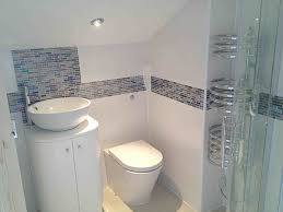 fully tiled small en suite with glass border with bathroom installation in leeds