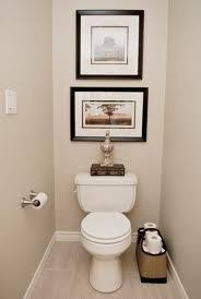 small space toilet design. simple decor in a small space - large square frame flanked by rectangular toilet design s