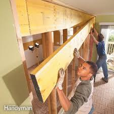 replace a load bearing wall with a microlam beam to create a bigger room