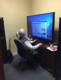 battlepsbattle old man using a huge tv as a computer screen i imgur com