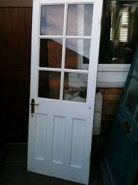 exterior wooden door with 6 clear glass panels repair to wood by hinge
