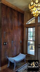 striking faux decorative paint finish on foyer walls by m m bender modern masters metal effects