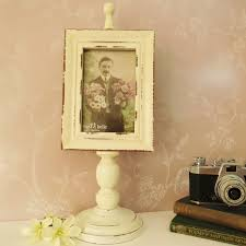 victorian style pedestal photo frame in vintage white lightly distressed to inspire that authentic vintage