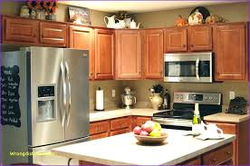 Kitchen Cabinets Decorating Holiday Decor Traditional Kitchen Mesmerizing Decorating Above Kitchen Cabinets