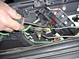 how to remove door panels on a 2000 jeep grand cherokee 2004 Jeep Grand Cherokee Driver Door Wiring Harness disconnecting door latch linkage rod, jeep grand cherokee 2004 jeep grand cherokee driver door wiring diagram