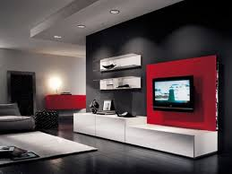 Tv Panel Designs For Living Room Tv On The Red Wall Panel Beside White Shelves On The Gray Wall