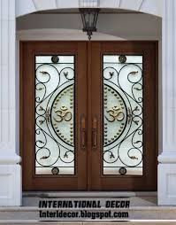 american wooden door with stained glass design and glided iron