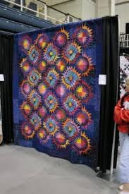 D is for Dovey: September 2009 & This quilt was in a vendor's booth. It was much more eye-popping in person,  all different batiks, pattern from the StrataVarious Quilts book. Adamdwight.com