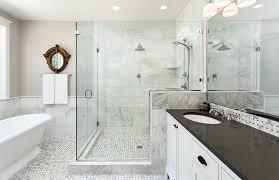 Black and white bathroom design with white vanity black countertop