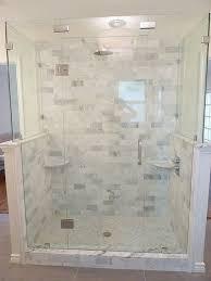 renovation master bathroom carrera marble frameless glass shower carrera marble subway tiles