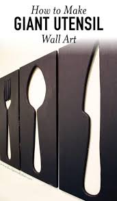 giant utensil wall art fork spoon and knife image